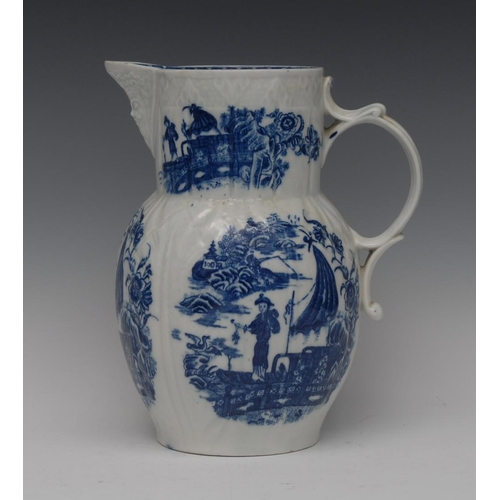 51 - A Caughley cabbage leaf moulded mask jug, printed in underglaze blue with the Cormorant Fisherman pa...