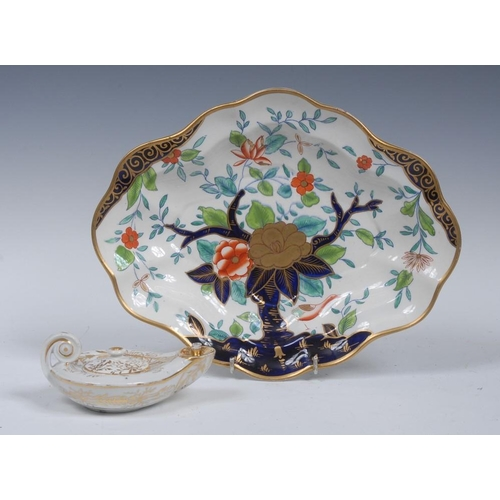 55 - A Coalport shaped oval dish, decorated with a stylised goose, peonies and tree, in cobalt blue, gree...