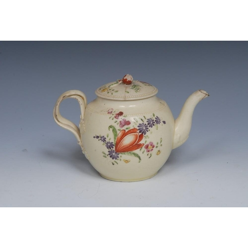 18 - An 18th century globular teapot and cover, decorated with stylised flowers and foliage in colours, b...