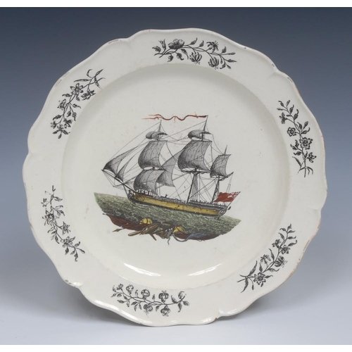 21 - An 18th century Wedgwood creamware scalloped plate, the centre transfer printed in black with a ship...