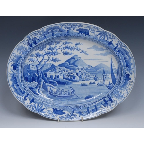 53 - A Spode Caramanian Series oval meat plate, transfer printed in tones of blue,  the border with eleph...
