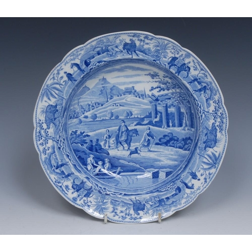 57 - A Spode Caramanian Series shaped circular bowl, transfer printed in tones of blue with City of Corin...