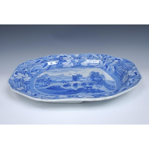58 - A Spode Castle and Bridge pattern shaped oval meat plate with well, transfer printed in tones of blu...