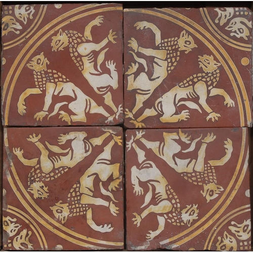 8 - A set of four Victorian Gothic Revival encaustic tiles, possibly Minton, each decorated in the Medie...