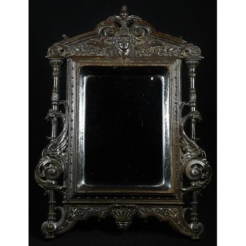5057 - A 19th century Renaissance Revival bois durci easel looking glass, rectangular mirror plate, the arc...