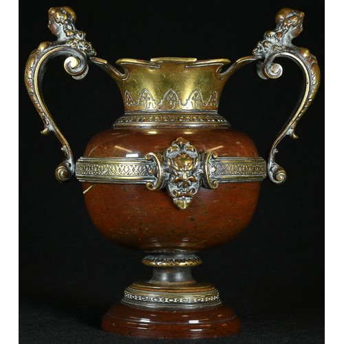 5032 - A 19th century gilt bronze mounted red marble mantel vase, each figural scroll handle as a female he...