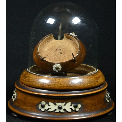 5054 - A 19th century pocket watch stand, hinged glass dome, turned base, applied with cut-card work, bun f...