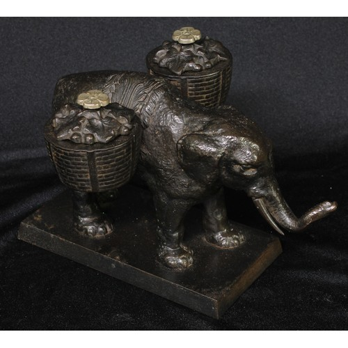 5020 - A 19th century cast iron novelty inkstand, as an elephant laden with baskets, rectangular base, 19cm...