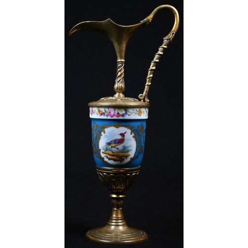 5033 - A 19th century gilt metal mounted porcelain ovoid ewer, painted in the manner of Sevres with fancifu...