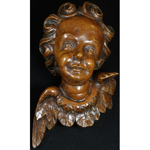 5041 - A 19th century Italian limewood carving, of a putto, 17cm long, dated to verso 1865...