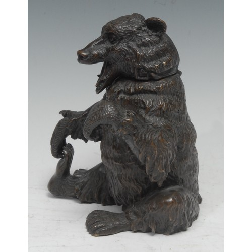 5040 - A 19th century Italian dark patinated bronze novelty table snuff, cast as a bear, seated scratching ...