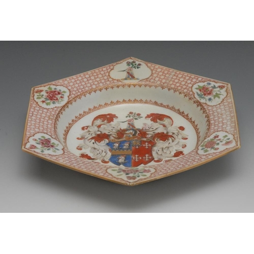 11 - A Chinese armorial porcelain hexagonal dish, painted in the Famille Rose palette, the border with th...