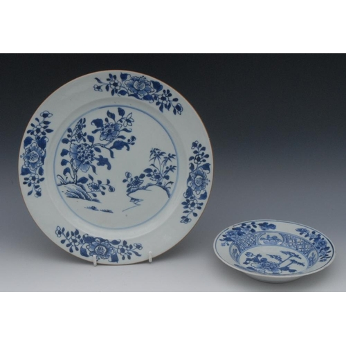 13 - A Chinese blue and white porcelain circular plate, painted underglaze with peonies and rocky outcrop...