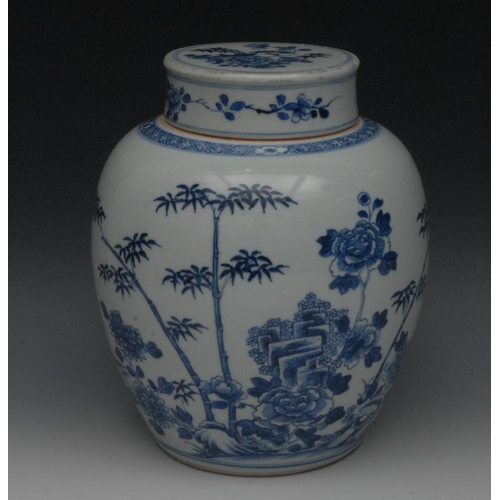 14 - A Chinese blue and white porcelain ovoid ginger jar and cover, painted with chrysanthemums, leafy ba...