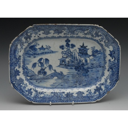 16 - A Chinese canted rectangular blue and white serving plate, painted with pagoda, rock trees, bridge a...