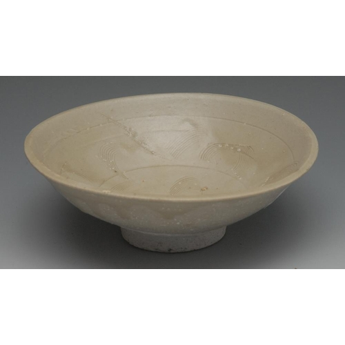 17 - A Chinese celedon bowl, incised, 15cm diam, in the Sung manner but later...