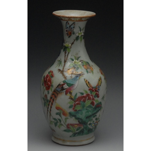 2 - A 19th Chinese bottle vase, decorated in polychrome with a fanciful bird, butterfly and peonies on a...