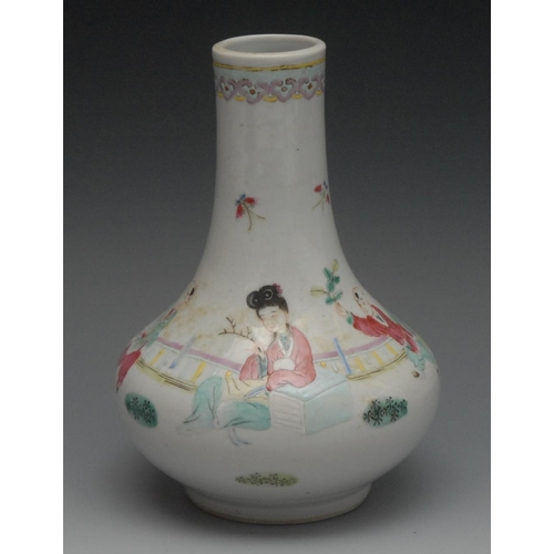 22 - A Chinese Famille Rose bottle vase, painted with oriental figure and boy attendant, 18cm high...