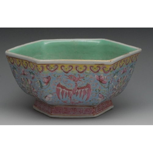 23 - A Chinese Famille Rose hexagonal bowl, decorated with phoenix and lotus in tones of red on an azure ...