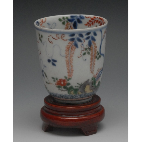 29 - A Chinese ogee shaped bowl, picked out in polychrome with a grasshopper amongst flora, red seal mark...