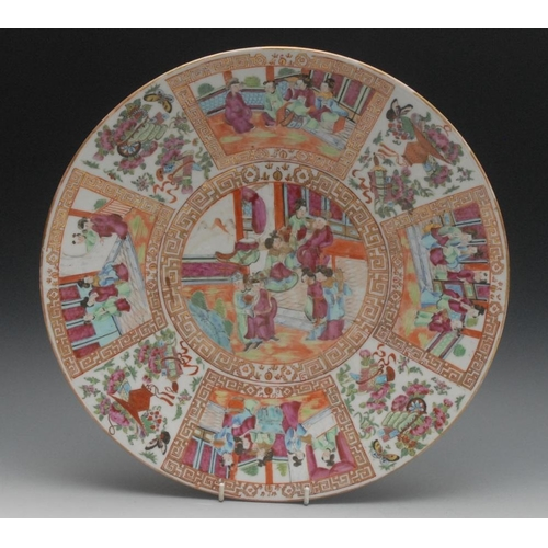 3 - A Cantonese Famille Rose circular charger, painted in the typical palette with figures and attendant...