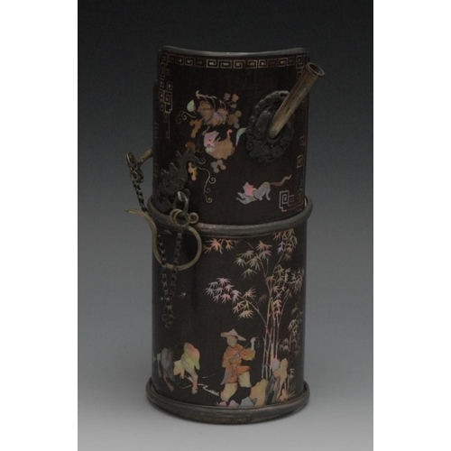 30 - A Chinese opium pipe, inlaid in mother-of-pearl with figure and bamboo, 20cm high...
