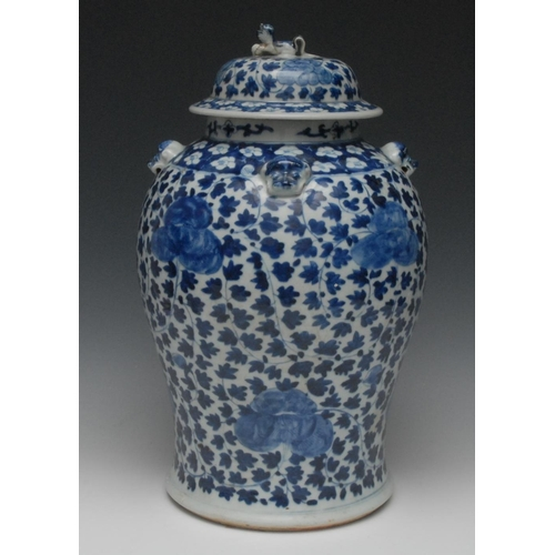 34 - A Chinese porcelain baluster jar and cover, decorated in underglaze blue with stylized flora, lion h...