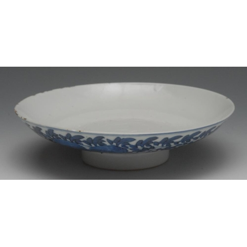 35 - A Chinese porcelain circular dish, painted in underglaze blue with flowers and leafy stems, 19cm dia...
