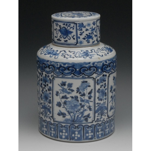 37 - A Chinese porcelain cylindrical jar and cover, painted in underglaze blue with birds, flowers and pr...