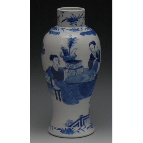 42 - A Chinese porcelain slender baluster vase, painted in underglaze blue with figures at a table laden ...