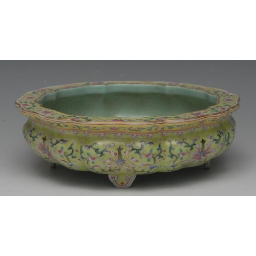 43 - A Chinese shaped circular bowl, decorated in pink, yellow, green and blue enamels with flowers and s...
