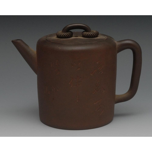46 - A Chinese Yixing cylindrical teapot, inscribed with characters, loop handle, 12cm high, impressed ma...