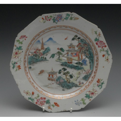 50 - An 18th century Chinese ten sided plate, painted in the Famille Verte manner with pagodas, trees and...
