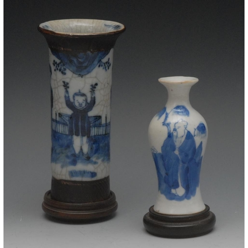 52 - An early 20th century Chinese flared cylindrical vase, decorated in underglaze blue with young boy a...