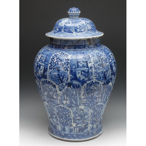 53 - A large 18th century Chinese jar and cover, painted in underglaze blue with lotus panels, alternatin...