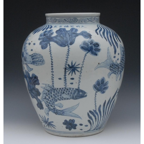 56 - A large Ming blue and white ovoid vase, painted in vibrant tones of cobalt blue with five fish, each...