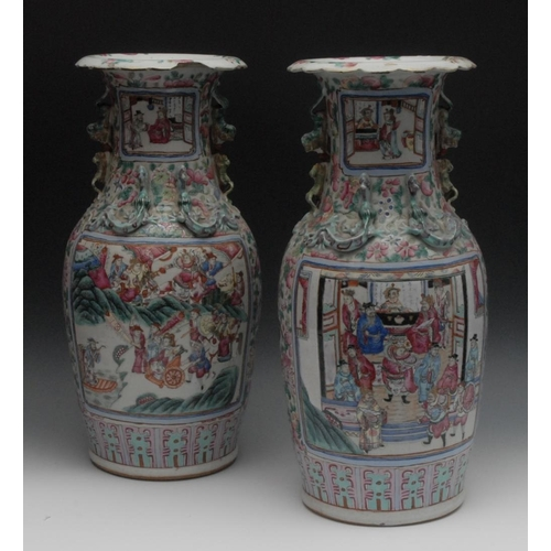 59 - A pair of Cantonese ovoid vases, each painted in the Famille Rose palette with an official and figur...