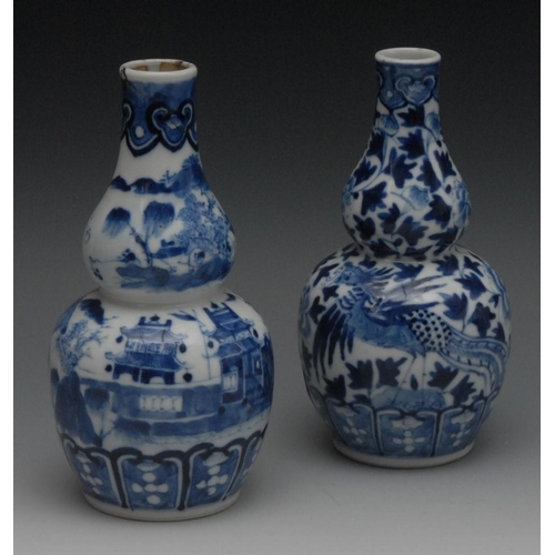 61 - A pair of Chinese double gourd bottle vase, decorated in underglaze blue with mythical beasts and fo...