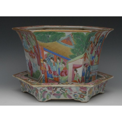 9 - A Chinese  Cantonese  Famille Rose jardiniere and stand, painted in polychrome with ladies of the co...