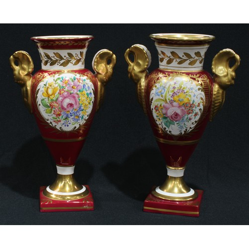 21 - A pair of French Empire style pedestal vases, scrolled swan handles, the central cartouches painted ...