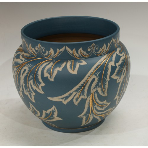 37 - A late 19th century Langley Ware jardiniere, incised decoration on a blue ground, impressed marks to...