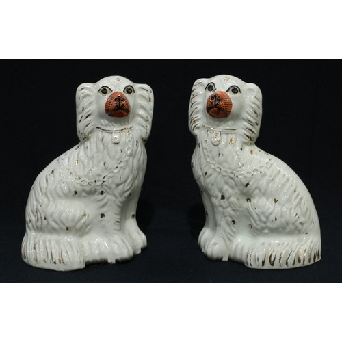 40 - A pair of Stafforshire King Charles Spaniel mantel dogs...