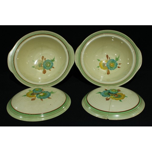 56 - A pair of Clarice Cliff vegetable dishes and covers...