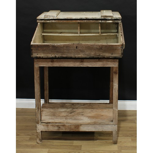 3 - Barn Salvage - an estate made pitch pine work table, of unusual vernacular lecturn proportions, shal...