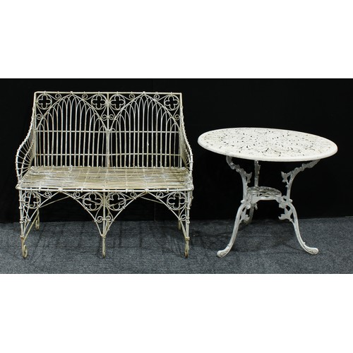 9 - A George III style wirework garden bench, in the Gothic Revival taste, 101cm wide; a Victorian style...