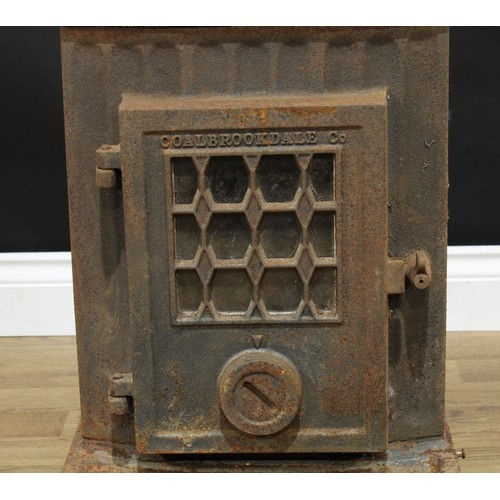 10 - A Coalbrookdale 'Little Wenlock' style cast iron burner, 53.5cm high, 38.5cm wide, 42cm deep...