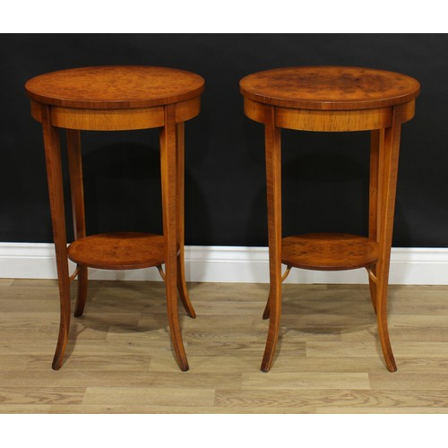 12 - A pair of contemporary Louis XVI style occasional tables, each with an oval top above a conforming u...