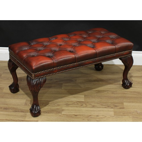 13 - A George II style stool, studded deep button 'rust' leather upholstery, cabriole legs carved to the ...