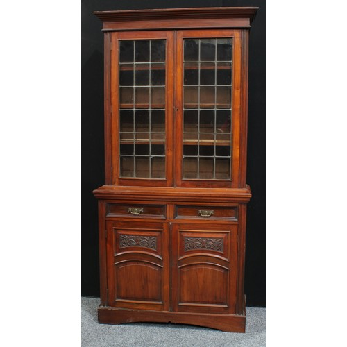 15 - A Victorian walnut bookcase, cupboards to base, c.1890...
