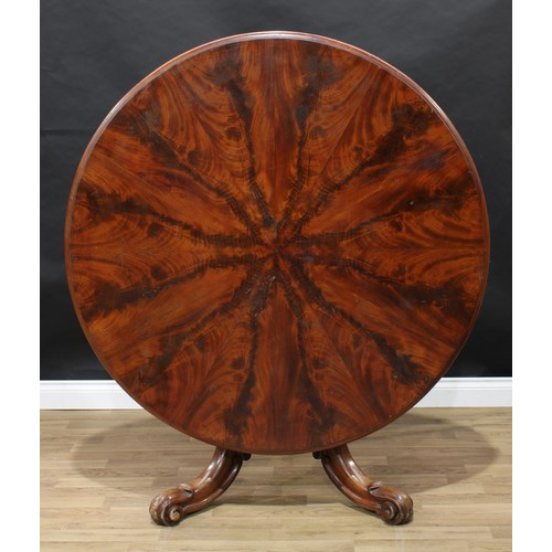 14 - A Victorian mahogany centre table, moulded top with segmented veneers, waisted panelled pillar, cabr...